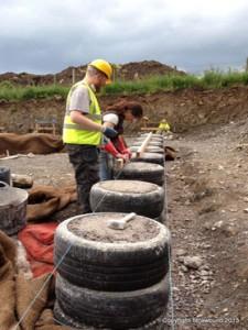 car tyres straw bale